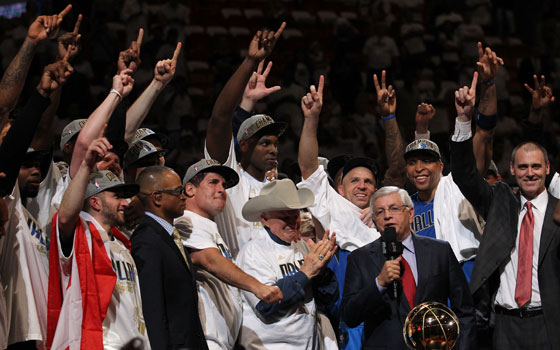 David Stern presents the Larry O'Brien Trophy to Mark Cuban and the Dallas Mavericks after Game 6 of the NBA Finals
